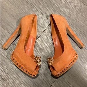 Alexander McQueen orange suede pumps